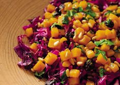 Warm Red Cabbage Salad with Sweet Potatoes - Crisp-tender, just-cooked cabbage serves as a warm salad base for seasoned sweet potatoes.