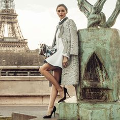 coat Nina Ricci, dress, necklace, and bag are Christian Dior, and shoes are Giuseppe Zanotti.