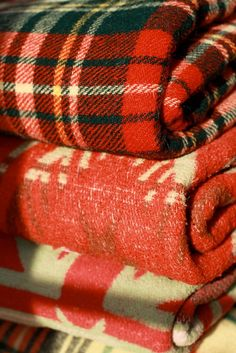 Cozy plaid and vintage blankets.