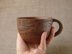 Tea-cup, made of red clay, decorated with hand-carved ornaments, and then fired in milk.