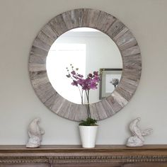 Round Wooden Mirror.  Maybe not this particular one, but some kind I round decorative mirror maybe above the bed I think may look nice