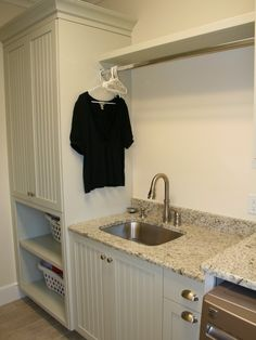 Laundry room idea- like this but with smaller sink and more counter. Maybe take cabinet up the wll and have counter above the sorting baskets
