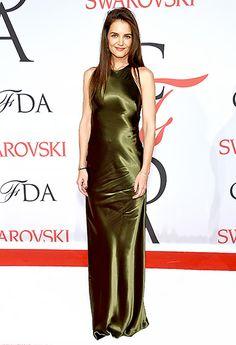 Katie Holmes stunned in a high-shine, moss-green Ralph Lauren halter dress with an open back.