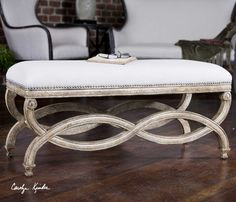The Karline Natural Linen Bench fits well with other Rough Luxe design elements. It has a hand carved, white mahogany frame with antiqued almond finish. Covering is natural linen and cotton with teflon fabric protector accented with champagne silver nails.
