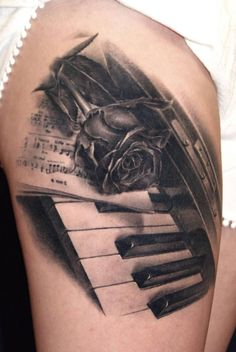 Nice Rose With Amazing Piano Keys Tattoo Design Idea