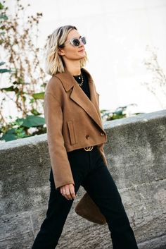 Adenorah stepped out in a fall outfit that instantly caught our eye thanks to her Tibi camel jacket. To be honest, we like to think of it more as a cropped camel coat since it reads more like one due to the bold lapels and bottom buttons. Pair with an all-black look and stylish shoes for a chic ensemble.