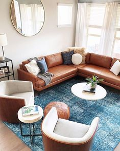 😍 @west_elm_austin #DesignCrew + @sabrinabeanatx carved out a cozy living space with the combination of an L-Shaped Andes Leather Sectional + 2 Luther Swivel Chairs. #WestElmDesignCrew #cozylivingroom #sofainspo #couchgoals