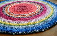 Community Clothes Rug | Flickr - Photo Sharing!    Beautiful rug-made from recycled clothing. I tried to crochet a rug when I was a teenager and it turned into a big dish!