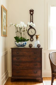 Creamy walls and polished wood floors are accented by a vintage wood cabinet. Home Living Room, Living Room Decor, Bedroom Decor, Traditional Decor, Traditional House, Home Decor Inspiration, Decoration, Diy Home Decor, Sweet Home