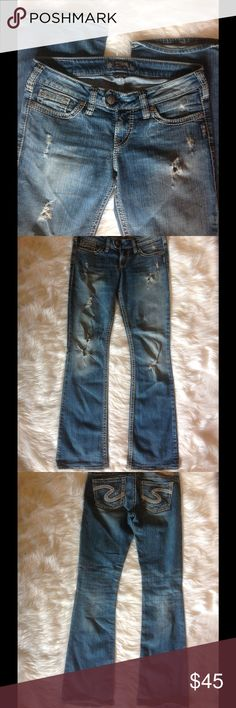 """Silver Jeans """"Tuesday"""" Distressed boot cut """"Tuesday"""" by Silver Jean Co. Size 28W & 33L. Excellent condition. Wear on hem is intentional and not from heavy wear. Made in Canada 99 % cotton 1% spandex. Double button closure with gold metal detailed button, White contrast stitching, and gold embellished rivets on jeans. Soft material with luxurious details of expensive jeans. Silver Jeans Jeans Boot Cut"""