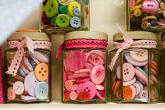 Jars of mixed colored buttons