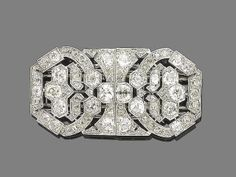 An art deco diamond double-clip brooch, circa 1920 The octagonal pierced plaque set throughout with rose, old brilliant-cut and cushion-shaped diamonds, cushion-shaped and old brilliant-cut diamonds