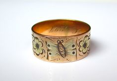 A Victorian ring engraved with flowers and a butterfly would be a pretty, sentimental choice.