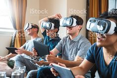 Group of friends playing games using virtual reality headsets royalty-free stock photo