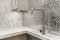 Metallic elements add a distinctive look that will renew a kitchen backsplash with a contemporary appeal to your home tile design - Stainless Steel Penny Round Metal Mosaic Tile https://www.tileshop.com/product/667683-P.do