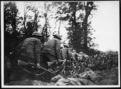 Daylight reconnaissance Royal Scots in No Man's Land, France, during World War I. This photograph shows a party of soldiers from the Royal Scots Regiment creeping along between a field and a hedge. The caption indicates they were advancing in 'No Man's Land', the ground between the Allied and German front line trenches.  The Royal Scots (The Royal Regiment) is Britain's oldest regiment, raised in 1633. It increased to 35 battalions during World War I, fighting in many areas and suffering…