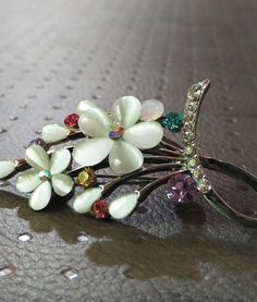 Bunch of Colours Beauitful Brooch. Pair it with your Indian or Western Dress to Look Fabulous #elegance #newarrivals #springqueen #brooches #festivefeel