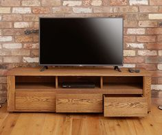 Baumhaus Olten Dark #Oak Large Widescreen #TVCabinet comes with #luxurious three #drawers comes with soft close drawers and cable holes to the rear of each shelf to allow for invisible wiring.  Price: £439.99