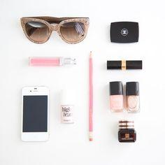 "Prada Sunglasses // Chanel Eyeshadow Duo in Taupe-Délicat // Dior Addict Gloss in Princess // Amanda Catherine Designs ""Be Fabulous"" Pencil // Chanel Lipstick in L'éclatante // Benefit High Beam Illuminator // Chanel Nail Polish in Pêche Nacré + Delight // Estée Lauder Advanced Night Repair Eye"