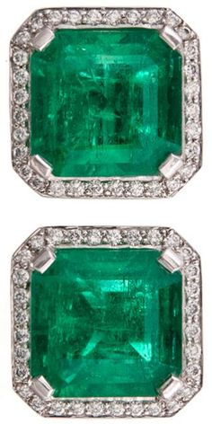 Important Colombian emerald diamond & platinum earrings. This pair of earrings represents some of the finest gemstone material known to man. Ideally matched for color, dimension and overall size, these emeralds exhibit a superior degree of transparency for stones with such an assertive carat weight of 4.96 carats and 4.91 respectively. Set in platinum and framed with 64 micro-set white diamonds, weighing 1 1/4 carat in total.