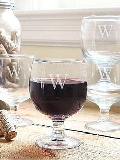 A wonderful gift for a holiday hostess, the Set of Four Personalized Stackable Low Stem Wine Glasses offers a personal touch to any bar and party.