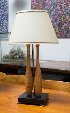A BESPOKE LAMP FEATURING VINTAGE INDIAN CLUBS