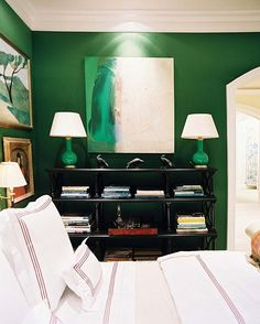 The artwork hanging in this bedroom is perfect. Pantone 2013 Color of the Year: 14 Emerald Green Rooms #homedecor