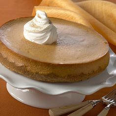 A gingersnap crust and ground ginger in the filling give this festive pumpkin cheesecake its rich ginger flavor.