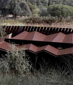 La Bodega Winery Designed by Spanish architects RCR Arquitectes, La Bodega is a winery situated on a private vineyard near the coastal town of Palamos. The architecture strikes a balance between the artificial and the natural, existing within a man-made valley cut into the Catalan landscape.