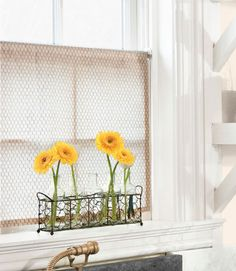 Chicken wire-print cotton cafe curtain (fabricsunlimited.net; enter CL20 for 20% discount); rack of bottles makes for an artful floral display