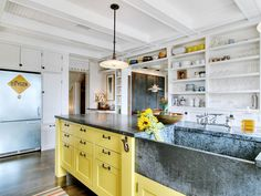 eclectic kitchen Eclectic Kitchen Love this oversize sink in the island. Awesome faucet and the built-in shelving behind is perfect.