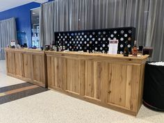 This is our custom built hickory wood bar! The wood is stunning, and will be the perfect bar addition for your next event!