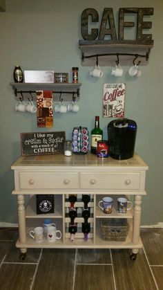 My new coffee bar inspired by Pintrest! Found the knick knacks and pole bar shel… My new coffee bar inspired by Pintrest! Found the knick knacks and pole bar shelves at Hobby Lobby and the buffet cart on Craigslist for freeee! Coffee Area, Coffee Nook, Coffee Corner, Wine And Coffee Bar, Coffee Bar Home, Coffee Drinks, Coffee Barista, Coffee Latte, Iced Coffee