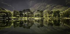 """https://flic.kr/p/yciYVa   Buttermere Back Light   Very nearly the shot of my dreams! On past visits to the """"Buttermere Pines"""" I've never been blessed with light or reflections. I wished that we'd arrived earlier as a slight breeze sprang up and quickly spoiled the show. My favourite shot from a memorable holiday!"""