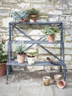 Crafted from metal with a powder coated whitewashed finish, our Como Plant Stand makes a beautiful display for your favourite flowers and plants. Suitable for use both indoors and out, each large stand includes three large slatted shelves and cross back details, all with a slightly distressed finish.  Click here to explore the rest of our Como Outdoor Collection.