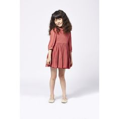 Made from 100% silk with a neat collar, puffed sleeves, a gathered skirt and back button fastening. Choose from Putty or Old Rose with gold glitter piping. Body fully lined. Available in sizes 3Y – 12Y