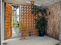 Kolaborasi Material Alam Pada Fasad Rumah Modern