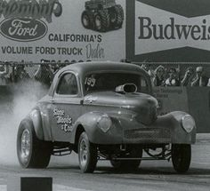 S-W-C . . . Mike Cook has been racing his father's famed Stone, Woods and Cook Willys since the 1970s. I remember first seeing it run at OCIR with a tunnel rammed big block Chevy. By the 1980s he had restored it to its original blown-Hemi AA/GS configuration. Mike still owns the car and his dad's '37 Chevy coupe today