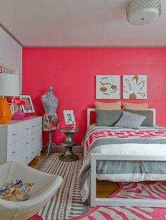 Ana Donohue Interiors - girl's rooms - coral pink, coral pink walls, coral pink wall color, headboard wall, accent wall, hardwood floors. Perfect for a deserving tween teen queen