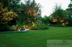 Add lighting to your flower beds so you can enjoy their beauty in the evening as well! #StewartLandDesigns