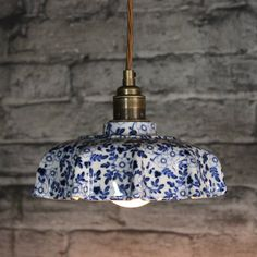A beautiful ceramic pendant light, handmade in the heart of the Potteries, in Stoke-on-Trent.The exterior is available in a toile du jouey, pimpernel or fern pattern colour glaze, with contrast cream tipping and cream interior. Our lights come with a 1.5 metre twisted fabric coated flex, as standard. You can choose either a chrome fitting with black cord, or a brass fitting with an old gold (light brown) cord. Please select from the drop down menu.Lyngard ceramics, have designed and ...