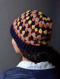 Yarnspirations.com | Add some colour to your outfit with this crocheted granny stripes hat. Slouchy and cool, this pattern is easily crocheted in Bernat Super Value yarn.