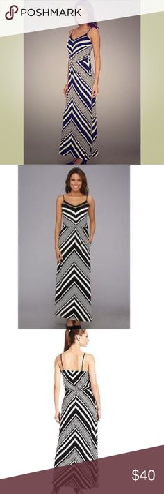 Vince Camuto Chevron Maxi Dress Size 10 Sleeveless Maxi Dress in a bold black and white Chevron print.  Contrast ladder stitch traces the v-neckline.  Adjustable spaghetti straps and elasticized waist band.  Onseam pockets! Lined bodice and slip on style.  Only worn once!! Like new. Vince Camuto Dresses Maxi