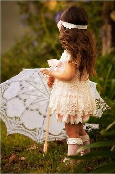 LOVE this!!! My mom has a picture of me (9 months old) with dress like this and an umbrella like that. I will definitely be recreating it with Allie.