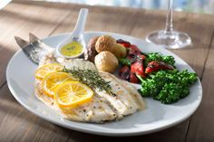 Our Lemon and Herb Roasted Whole #Branzino is served with Meyer lemon and fresh #thyme.