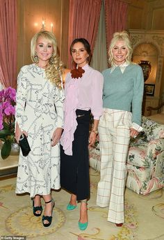 Victoria Beckham looked stylish in a sheer pink blouse which featured dramatic ruffle detailing and a large red floral collar at the Suzanne Rogers Presents event in Toronto on Wednesday. Victoria Beckham Outfits, Victoria Beckham Style, Outfit Of The Day, Toronto, Cool Style, Ruffle Blouse, Mail Online, Daily Mail, Stage