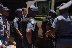Oscar being taken into custody by the South African Police.