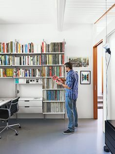 """""""It's like Lego for grown-ups,"""" Fissmer says of Rams's 606 Universal Shelving System for Vitsœ, which makes another appearance in the office. """"It's a responsible way to handle storage."""""""