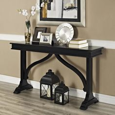 Features: -Table can be used in living room, entry or dining room. -Solid Wood and wood veneer construction. -Finish: Black. -1 Year warranty. -Distressed finish. Top Finish: -Black. Distressed