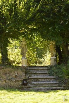 Steps and statues in the garden of a castle in the...